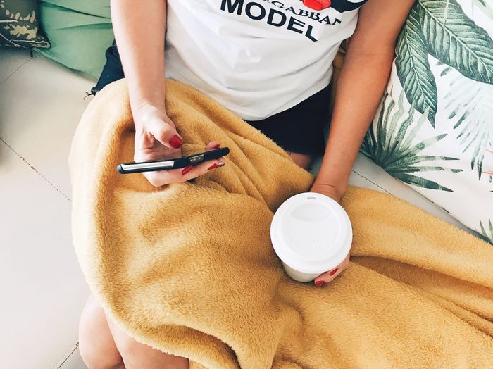 One Person High Angle View Real People Midsection Lifestyles Indoors  Women Holding Adult Sitting Relaxation Leisure Activity Casual Clothing Nail Nail Polish Front View Writing Bed Human Body Part
