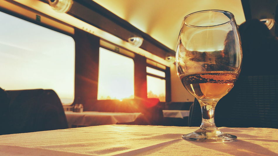 Wineglass Traveling Sunset Beer Beer Time Dining Car Oldschool Slow Life Having A Beer Having A Drink Nice View Traveling Photography Travelphotography Alcohol Drink Wine Table Drinking Glass Window Close-up Food And Drink Alcoholic Drink