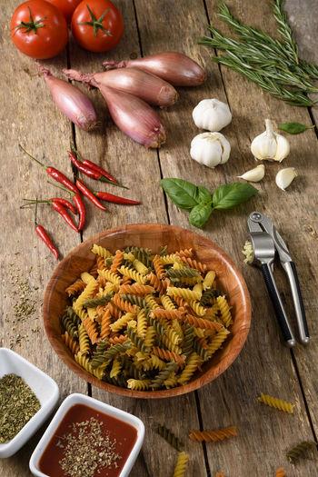 Pasta dish preparation on wooden background Fusilli Garlic Pasta Dish Chilli Food And Drink Fusilli Pasta Healthy Eating Pasta And Veg Pasta Preparation Pasta Time First Eyeem Photo