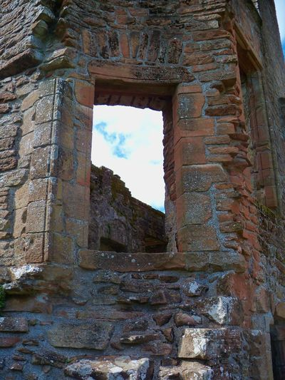 Inside of Caerlaverock Castle, the historical seat of the Maxwell clan, near Dumfries, Scotland. Ancient Arch Architecture Built Structure Caerlaverock Castle, Maxwell Clan, Dumfries, Scotland, Castle, Window, Stone, Architecture, Building, Sky, History, Genealogy Cloud Cloud - Sky Damaged Day Deterioration Historic History Low Angle View No People Old Old Ruin Ruined Run-down Sky Stone Material The Past Travel Destinations The Great Outdoors - 2018 EyeEm Awards