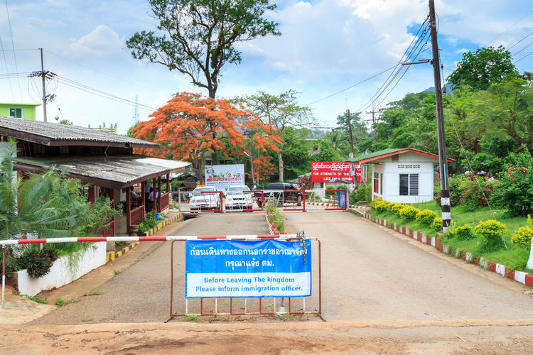 The border between Thailand and Myanmar Architecture Autumn Border Building Exterior Built Structure Cable Communication Day Electricity Pylon Immigration International Border Myanmar Nature No People Outdoors Sky Text Thailand Transportation Travel Traveling Tree