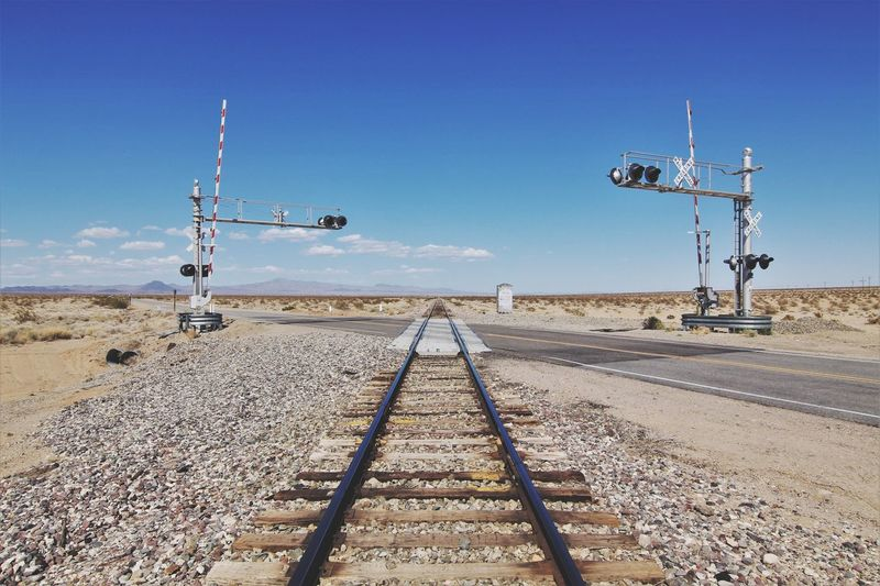 Nowhere land Roadtrip Sky Nature Sunlight Day Direction The Way Forward Transportation vanishing point No People Rail Transportation Diminishing Perspective Track Technology Connection Railroad Track Metal Outdoors Visual Creativity
