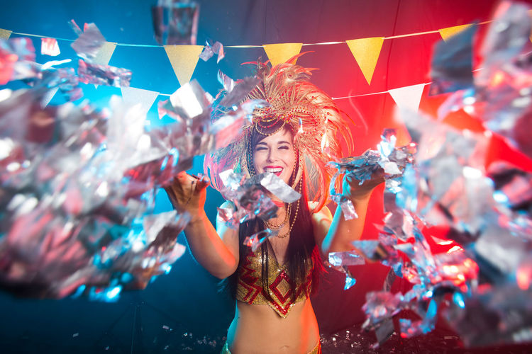 Smiling woman throwing confetti