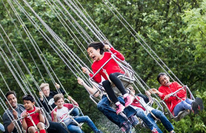 Kids enjoying a joy ride in a theme park Adrenaline Junkie Chessington Chessington World Of Adventures England Enjoyment Excited Fear Fun Joy Joy Ride Joyride Leisure Activity Lifestyles Need For Speed Theme Park Uk