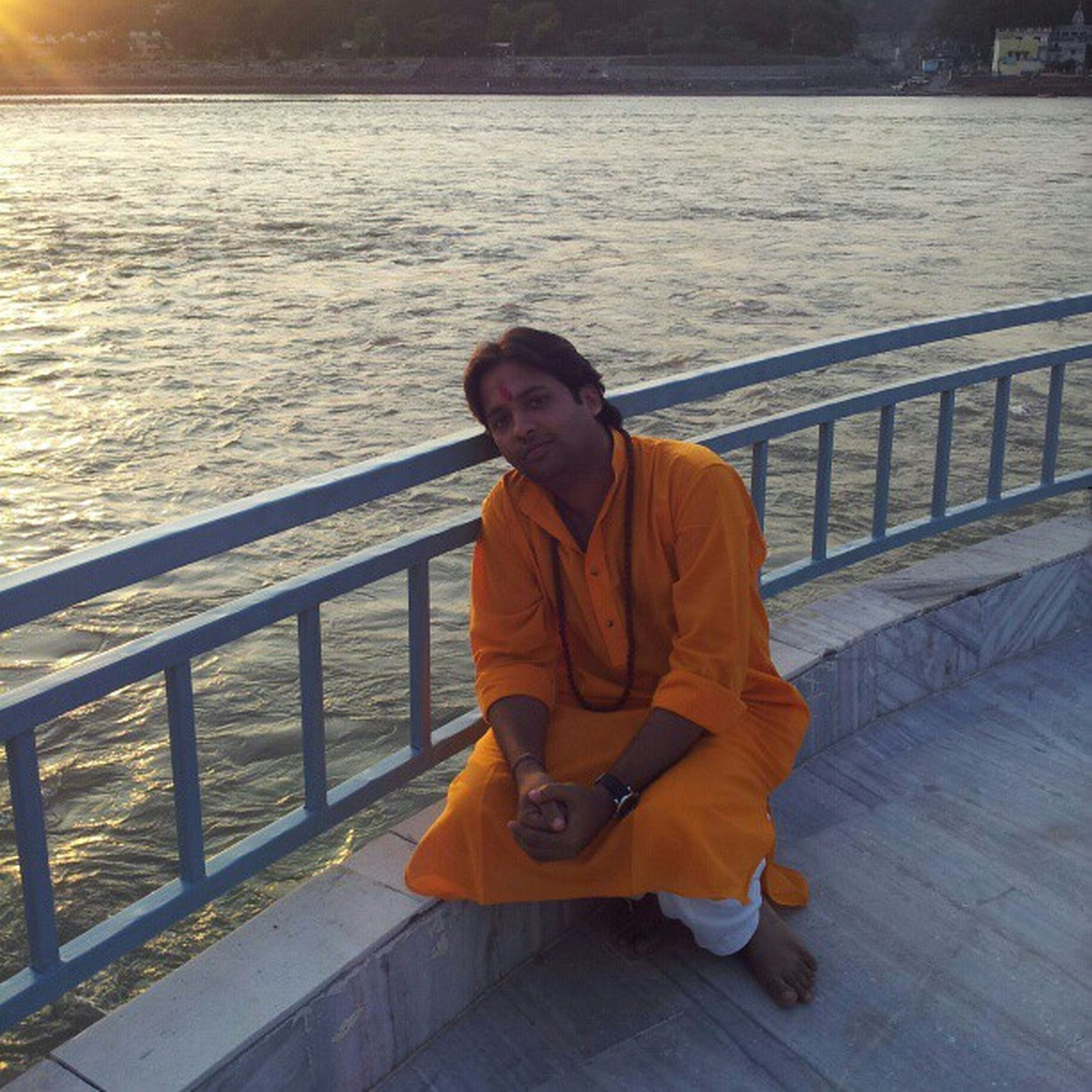 lifestyles, young adult, person, casual clothing, water, leisure activity, sitting, portrait, looking at camera, railing, full length, standing, smiling, river, front view, young men, three quarter length, transportation