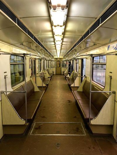 Interior of illuminated empty metro train