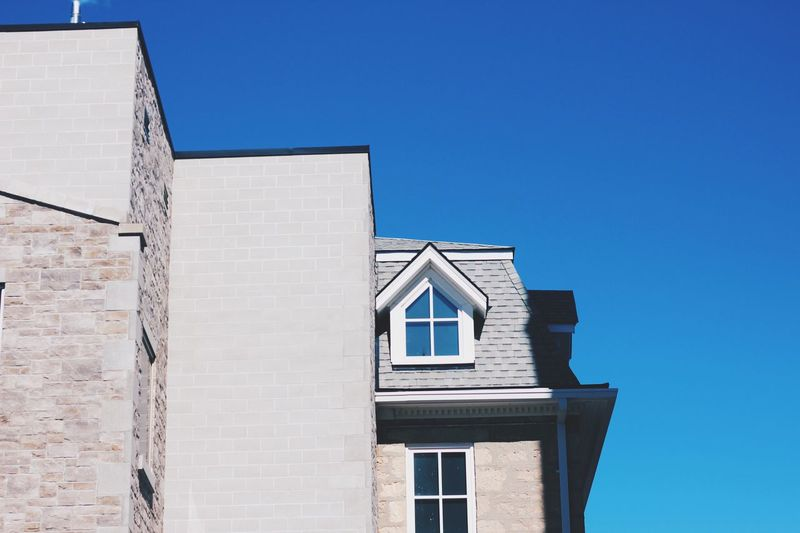EyeEmNewHere Architecture Building Exterior Built Structure Blue Clear Sky House Residential Building Window Low Angle View Outdoors Sky Whitewashed