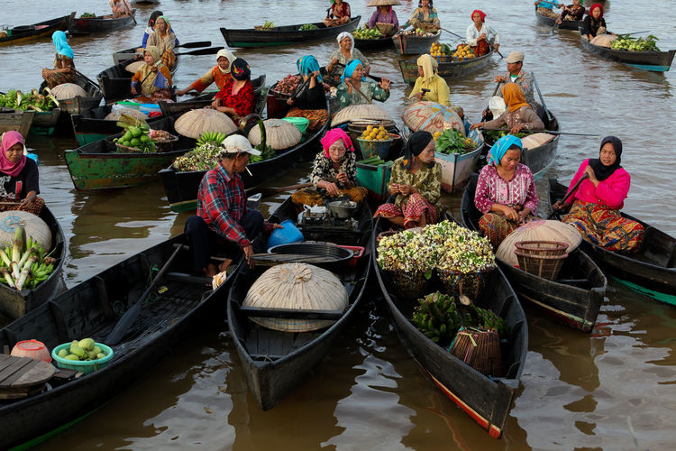 Banjarmasin Floating Market Food Gondola - Traditional Boat High Angle View INDONESIA Large Group Of People Lokbaintan Nautical Vessel Occupation Outdoors People Real People Selling Sitting Transportation Women