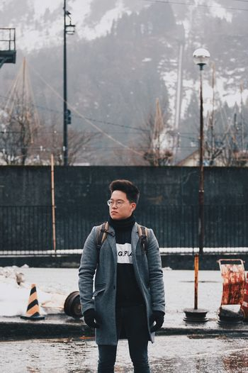 Portrait of young man standing in winter