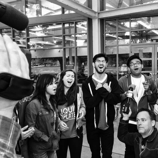 Shooting live local morning show now California Live Television Morning A Cappella Student Life Blackandwhite Photography Monochrome Smiling Real People Street University Campus Standing Lifestyles Togetherness Friendship Crowd