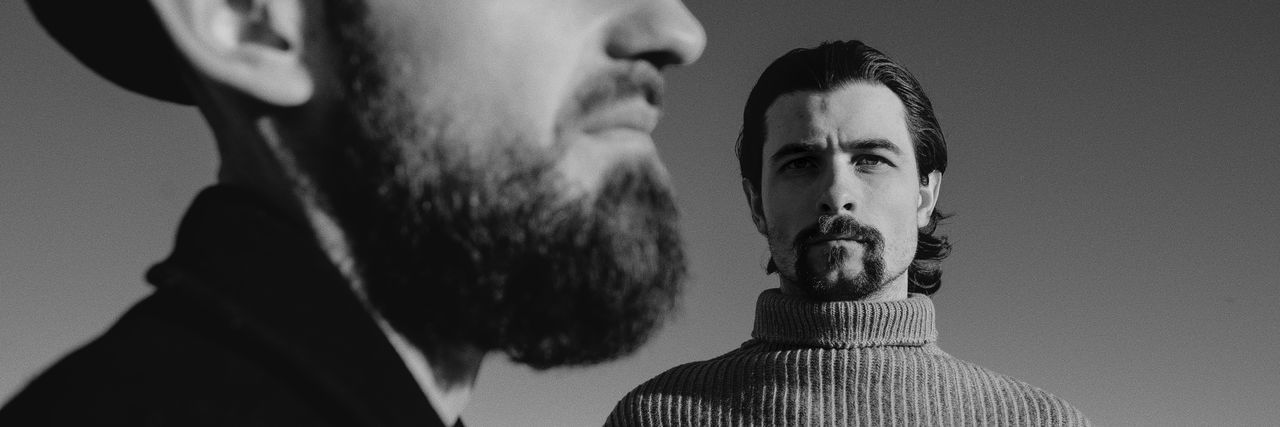 A series of black and white photos on the beach in a winter sunny day. Shooting by the sea. Portraits with natural light. Candid Authentic Moments Authentic Lifestyles Lifestyle Life Is A Beach Blackandwhite Black And White Young Men People Men Real People Beard Headshot Young Adult Portrait Facial Hair Togetherness Adult Leisure Activity Mid Adult Men Human Body Part Two People Focus On Foreground Aggression