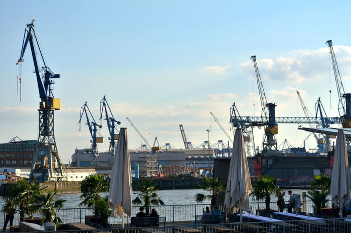 Cloud Cloud - Sky Commercial Dock Construction Construction Machinery Construction Site Crane Crane - Construction Machinery Development Elbe River Hamburg Harbour Harbor High Section History Industry Nikon Nikon D5200 Nikonphotography No People Outdoors Progress Shipping  Sky Tall - High Tranquility Adapted To The City Miles Away The Great Outdoors - 2017 EyeEm Awards