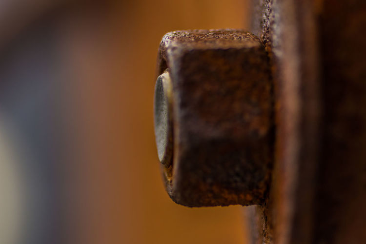 Extreme close-up of rusty metallic nut