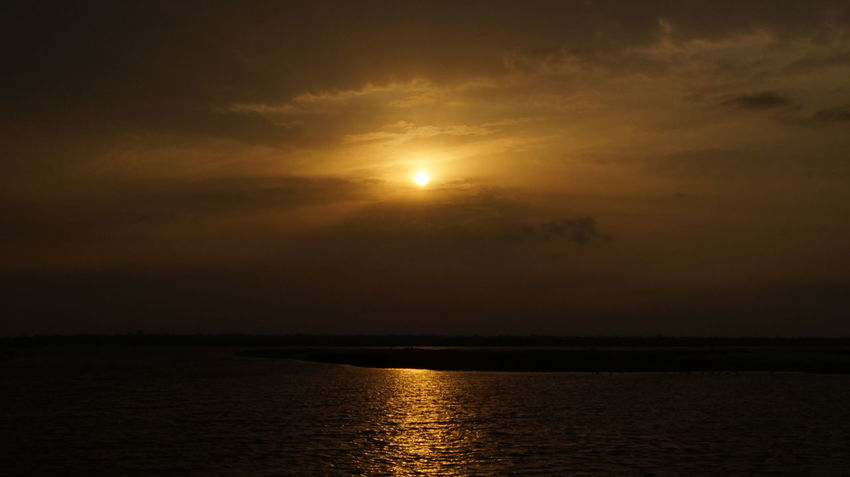 SUNRISE ON THE BANKS OF PADMA RIVER Beauty In Nature Horizon Over Water Landscape Moon Nature No People Outdoors Reflection Scenics Sea Sky Sun Sunrise_sunsets_aroundworld Tranquil Scene Tranquility Water