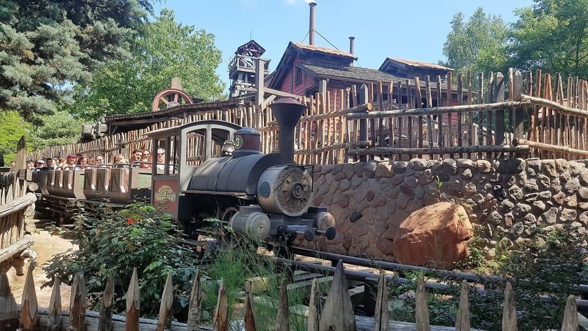 """Here is a Photo shot of Big Thunder Mountain """"Train 3"""" Arriving back to the Offloading and Loading Station just after a Runaway Adventure around the Big Thunder Mountain. This roller coaster is located within Frontierland - Disneyland Park - Disneyland Resort Paris. 2017 2017 Year 25th Anniversary Disneyland Paris Architecture Big Thunder Mountain Railroad Building Exterior Built Structure Day Disneyland Paris Disneyland Paris 💚🎆🗼 Disneyland Resort Paris Disneyland Resort Paris 2017 Disneyland Resort Paris 25th Anniversary Disneylandparis Eurodisney Growth Nature No People Outdoors Paris, France  Plant Rollercoaster Sky Tree Water"""