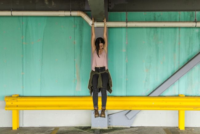 hanging by a thread. City Canon Female Portraits Yellow Around The City  Parking Lot Girls Models Portait Photography Cityscape Walking Around The City  Fashion Parking Garage Symmetrical Hanging