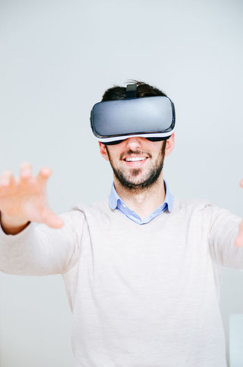 Man with virtual reality simulator