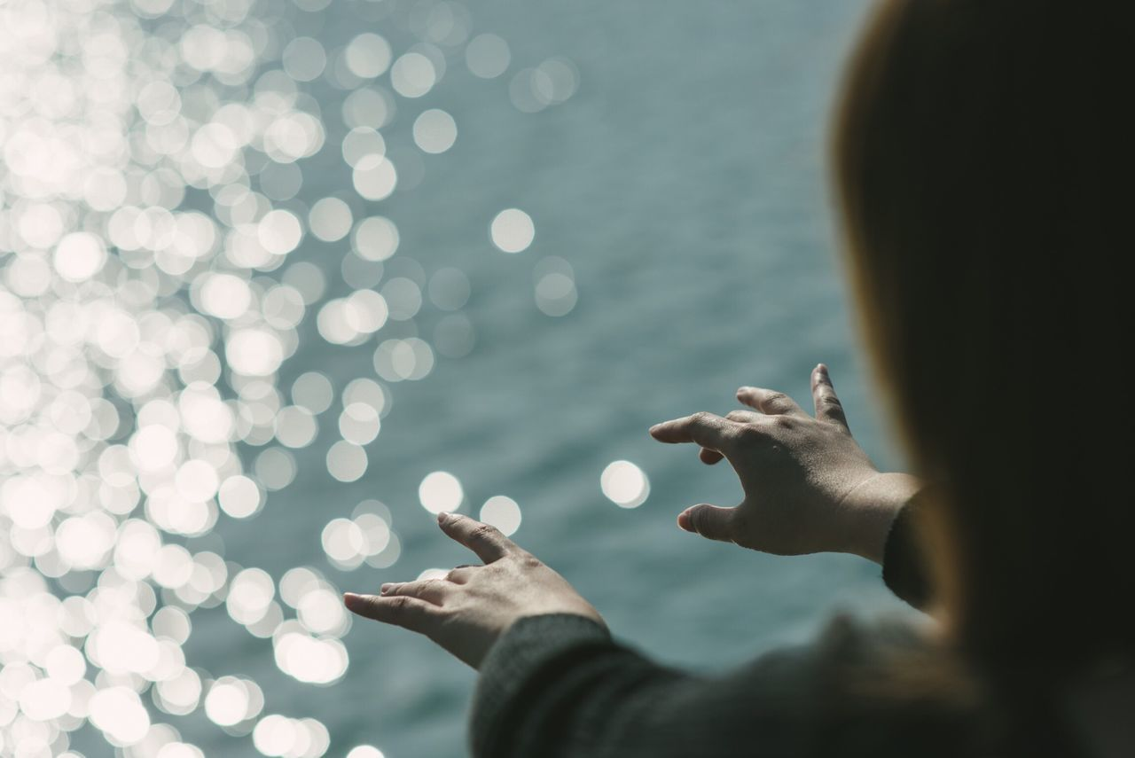 Cropped Image On Girl Playing Air Piano Against Sea