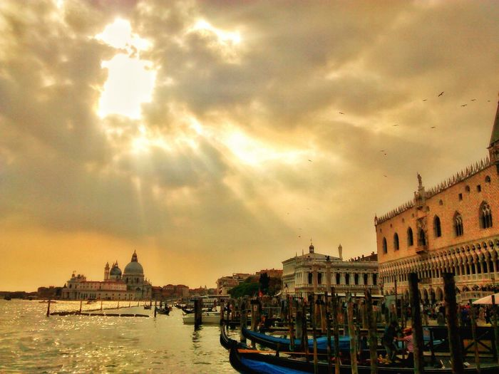 EyeEmNewHere Architecture Cloud - Sky Sky Travel Destinations Nautical Vessel History Built Structure Building Exterior Sunset Water Outdoors City No People Cityscape Day Gondola - Traditional Boat