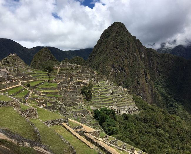 Machu Picchu Cloud - Sky Sky Mountain Tranquil Scene Nature Beauty In Nature Tranquility Landscape Day Green Color Outdoors Travel Destinations Mountain Range No People