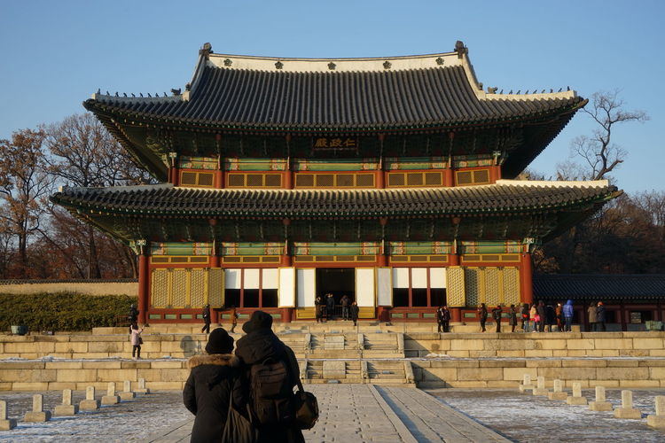 Changduk Palace Korean Traditional Architecture UNESCO World Heritage Site Winter Adult Adults Only Architecture Building Exterior Built Structure Day Large Group Of People Lifestyles Men Outdoors People Real People Seoul City Sky Snow Standing Travel Destinations Women