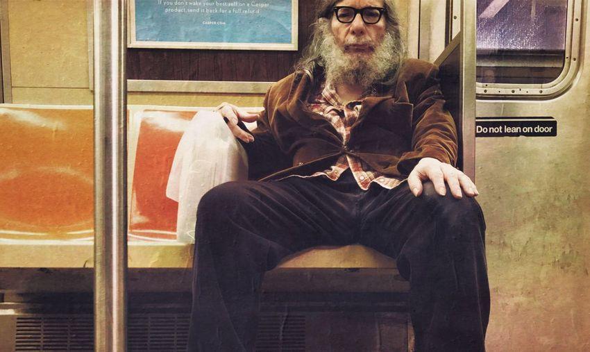 Full length of man sitting