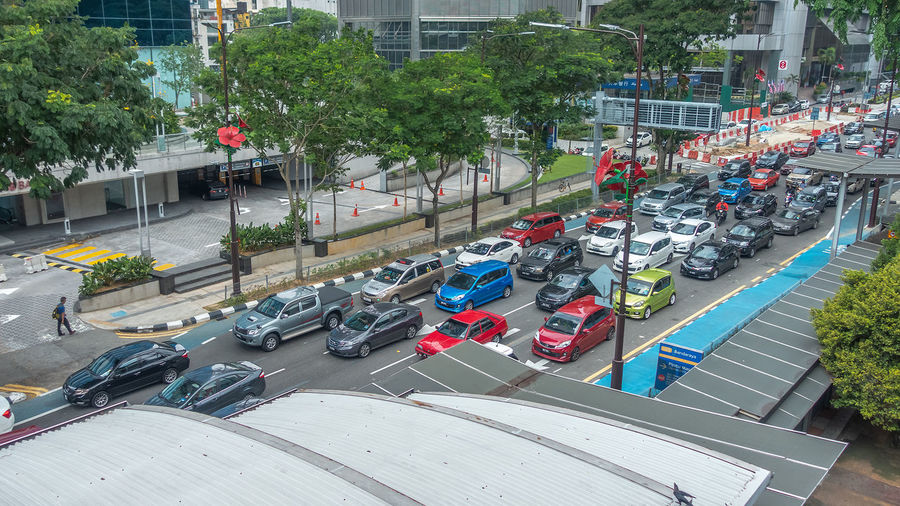 Traffic jam during festive seasons in Kuala Lumpur Eid Mubarak Festive Season One Way Queue Architecture Building Exterior Built Structure Car City City Life Congestion Day High Angle View Incidental People Land Vehicle Mode Of Transportation Motor Vehicle Outdoors Plant Public Transportation Road Street Traffic Transportation Tree