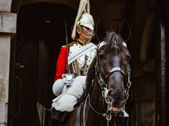 Portrait of soldier riding horse