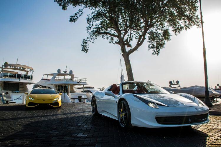 Car Beach Transportation Blue Outdoors Yachting Dubai UAE UAE , Dubai Middle East Emirates Dubai❤ Automotivephotography Cars Of Dubai Cars Automotive Photography Lamborghini Huracan Lamborghini Lambo Ferrari Ferrari 458 Nautical Vessel Ferrari 458 Spider Mode Of Transport Tree