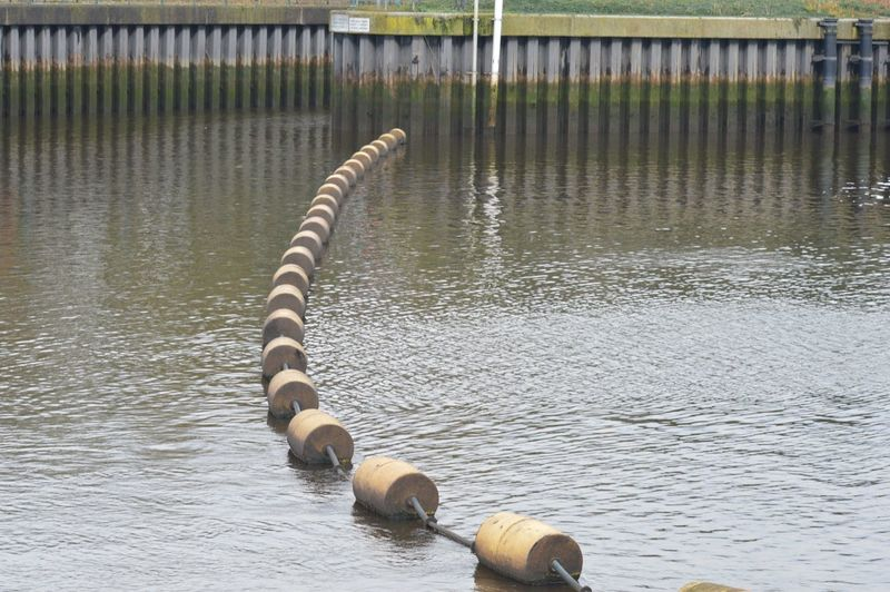 High Angle View Of Buoys Arranged On River