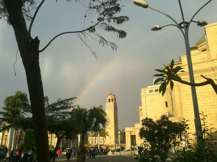 EyeEmNewHere Great Building History Egypt Cairo Sunny Outdoors Outside Rainbow After Raining Clear Sky Cairo University Outing University Sky Day Architecture Yellow Trees Green Plants