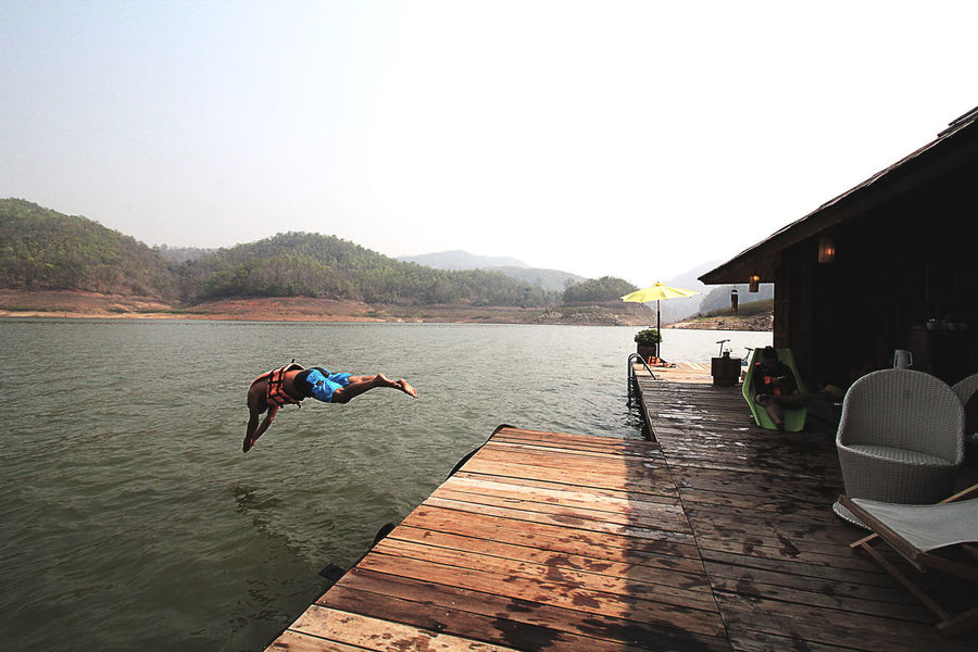 Man Jumping into River. Mae Ngat, Chiang Mai, Thailand Beauty In Nature Capture The Moment Darkness And Light Day Lifestyles Mae Ngat Mountain Nature Ohmphotography Outdoors Selective Focus Sky Stop Motion Tourist Vacations Water