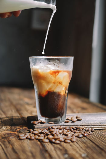 ice coffee + fresh milk The Still Life Photographer - 2018 EyeEm Awards Drink Quality Drinking Glass Motion Preparation  Wood - Material Coffee - Drink Filling Pouring Scented Caffeine Latte Iced Coffee