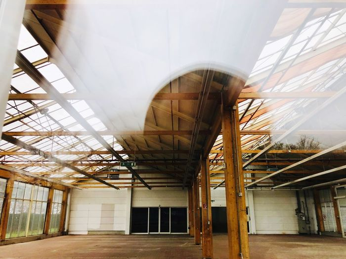 Architecture Built Structure Day No People Low Angle View Outdoors Building Exterior Arts Culture And Entertainment Metal Building Sky Roof Nature Old Ceiling Plant Greenhouse Entrance Architectural Column