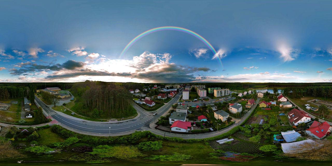 HIGH ANGLE VIEW OF RAINBOW OVER CITY
