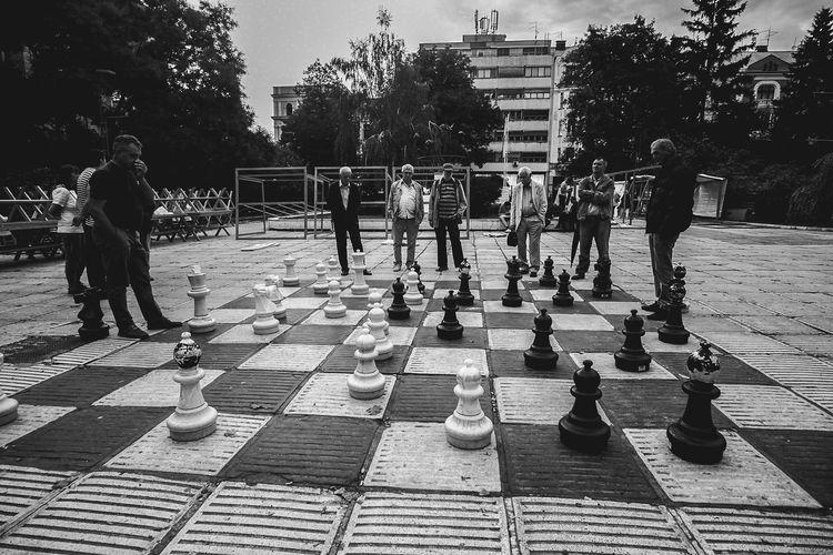 Full length of men playing on street in park