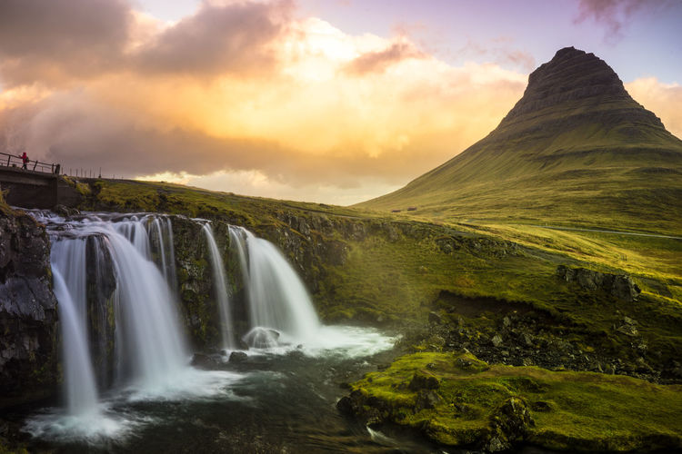 Kirkjufell Mountain, Iceland, Landscape with waterfalls in morning light Scenics - Nature Beauty In Nature Sky Environment Waterfall Cloud - Sky Long Exposure Water Nature Sunset Flowing Water Motion Tranquil Scene Mountain Non-urban Scene No People Landscape Tranquility Outdoors Flowing Power In Nature Falling Water Iceland Nature_collection