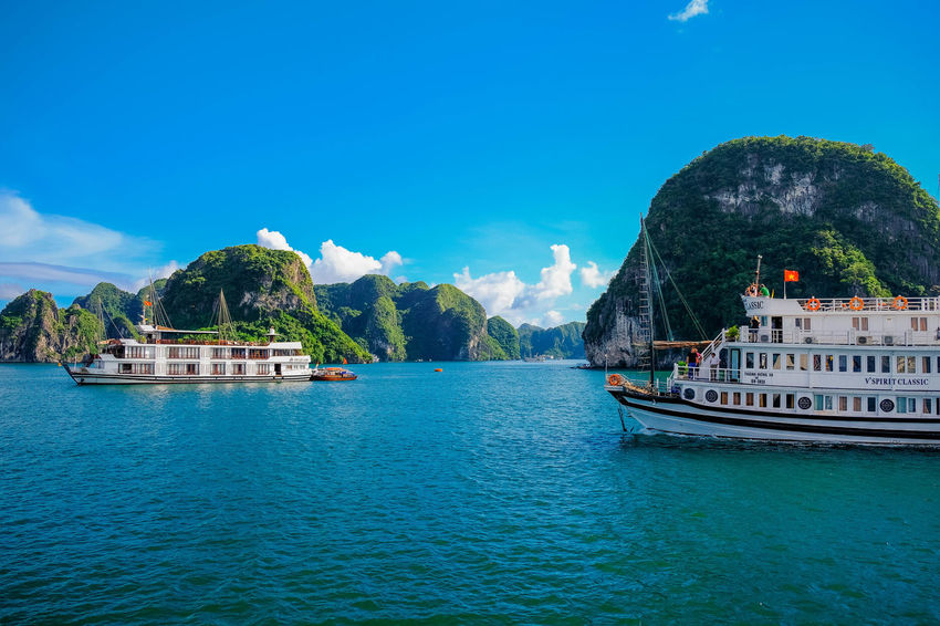 Floating along in Halong Bay Architecture Beauty In Nature Building Exterior Built Structure Day Mode Of Transportation Mountain Nature Nautical Vessel No People Outdoors Passenger Craft Plant Scenics - Nature Sea Sky Transportation Travel Tree Turquoise Colored Water Waterfront