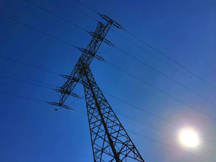 power from the grid view at the electrical tower Blue Cable Electric Current Electrical Current Electrical Tower Electricity  Electricity  Electricity Pylon Energise Energised Energize Energized Energy Power Power Cable Power Line  Power Pole Power Supply Sky Sun Sunny Utility Pole Wire