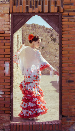 Andalucía Flamenco Spanish Woman Architecture Brick Wall Bride Building Exterior Built Structure Day Lifestyles One Person Outdoors People Real People Red Standing Young Adult Young Women