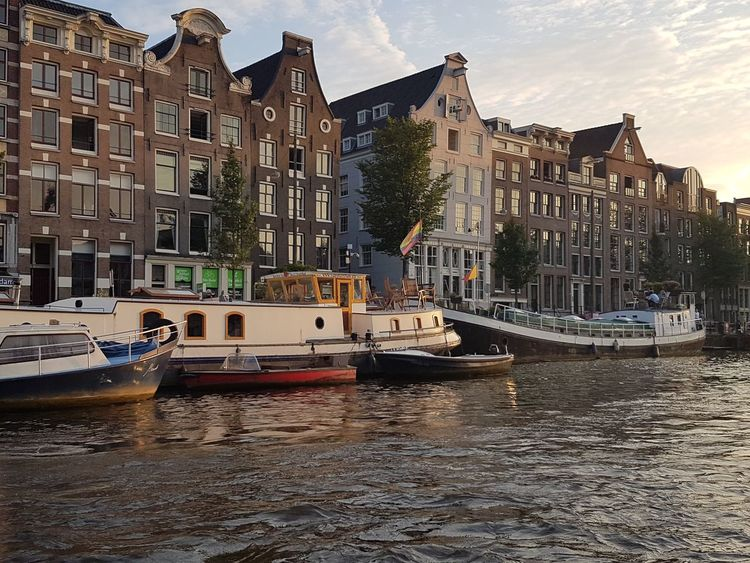 Nautical Vessel Water Cityscape No People Sea Yacht Building Exterior Apartment Outdoors Tall Ship Sky City Travel Destinations Travelling Tranquility Travel Photography Horizon Over Water Amsterdam Canal Canal Amsterdam River Day Sailing Ship