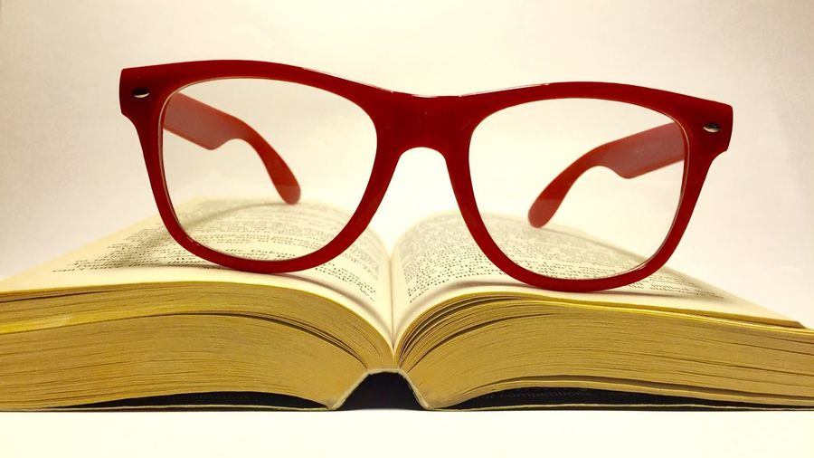 Time to relax with a good book 📚 Book Sunglasses Education Page Eyeglasses  Open Close-up White Background No People Eyesight Day Optician Redglass Reading A Book Badeyes Redglasses Reading Books