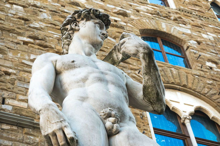 Low angle view of david statue against historic building