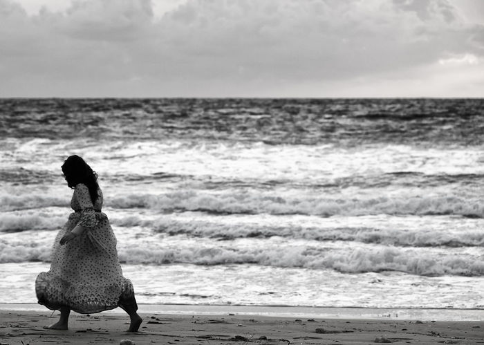 Woman and the Sea Loneliness Lonely Animal Themes Beach Beauty In Nature Bird Day Full Length Horizon Over Water Lost At Sea Nature One Animal One Person Outdoors People Real People Scenics Sea Shipwreck Shipwreck Beach Shipwrecked Sky Stranded Tranquility Water Wave Waves