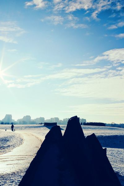 Sky Sea Beach Leisure Activity Water Relaxation Nature Lifestyles Real People Sand Scenics Day Vacations Beauty In Nature Outdoors Women Men One Person Horizon Over Water Human Body Part Snow Covered Frozen Cold Temperature Snow Nature Adapted To The City