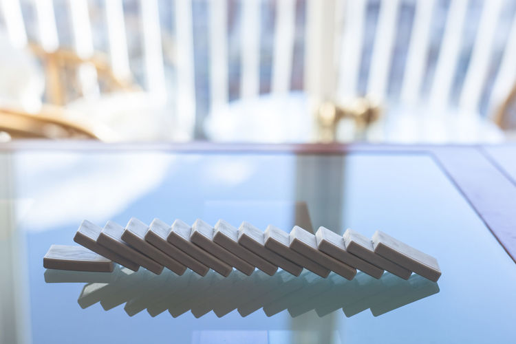 Close-up of dominos on glass table