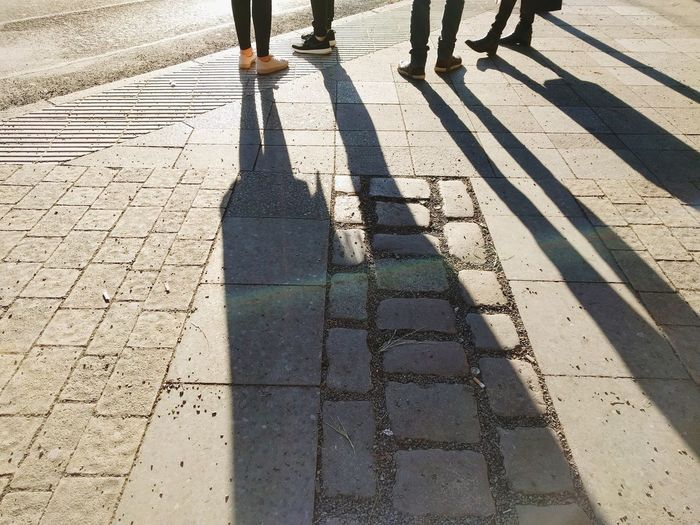 Shadow Sunlight Real People Leisure Activity Low Section Human Body Part Outdoors Human Leg Long Shadow - Shadow Lifestyles Men Walking Togetherness Women People Adult Berliner Ansichten Berlin Winter Light And Shadow Sunlight Commuting Cityscape Friendship The City Light
