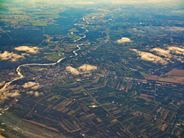 Aerial landscape around river farming lands looks like patchwork Aerial View Environment Landscape Agriculture Field Rural Scene Land Scenics - Nature No People Nature Beauty In Nature Day Farm Outdoors Patchwork Landscape Green Color Transportation High Angle View Tranquil Scene Tranquility