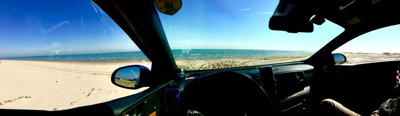 IPHONE-PHOTO 180° Vehicle Interior Sea Transportation Windshield Sky Horizon Over Water Car Interior Beach Mode Of Transport Steering Wheel Dashboard Day Blue No People Nature Land Vehicle Water Beauty In Nature Close-up Outdoors
