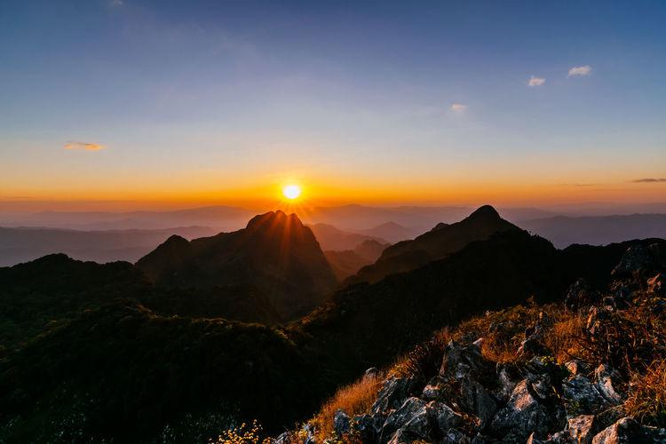 sunset at top of mountain beautiful sky Astronomy Tree Mountain Sunset Galaxy Fog Dawn Sunlight Mountain Peak Pinaceae